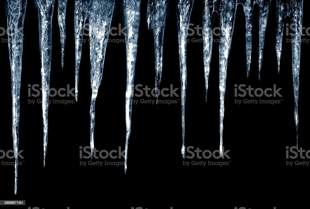 Icicles on Black Background stock photo