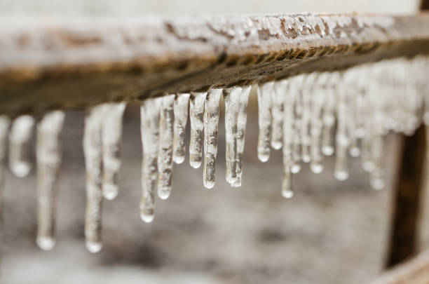 icicles on granite table edge during spring ice storm - low contrast stock pictures, royalty-free photos & images