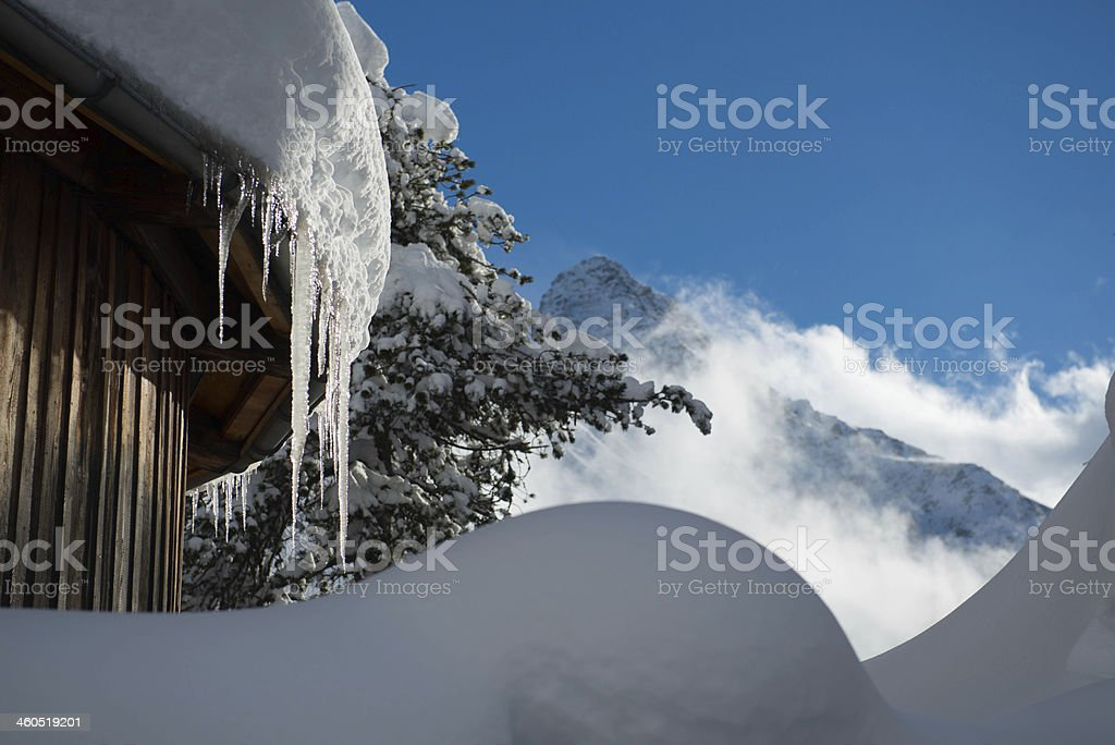 Icicles on house roof royalty-free stock photo