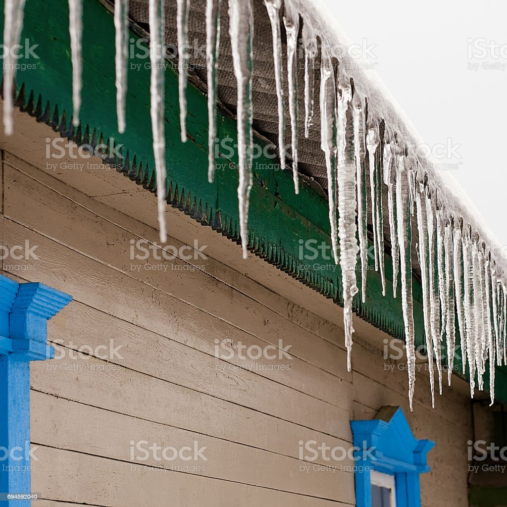 Icicles on the roof stock photo