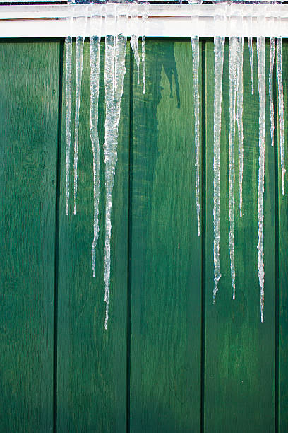 Icicles on the Side of a House stock photo