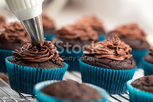 Icing cupcakes - Please see my portfolio for other food and drink images.