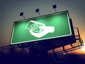 istock Icon of Money in the Hand on Green Billboard. 459879451