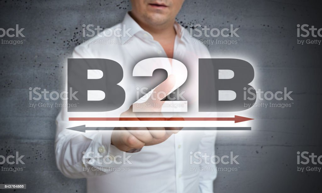 B2B Icon touchscreen is operated by man stock photo