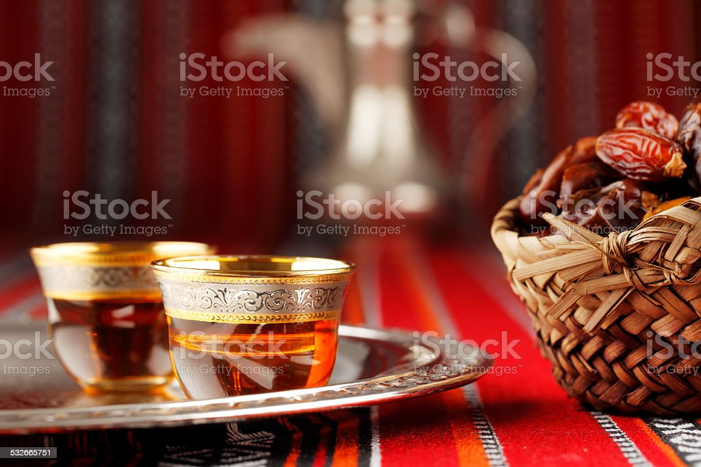 Iconic Abrian fabric with Arabic tea and dates stok fotoğrafı
