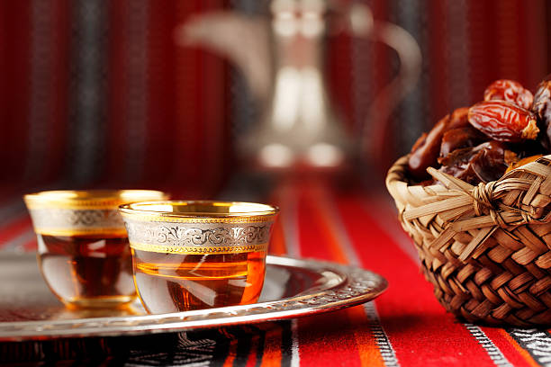 Iconic Abrian fabric with Arabic tea and dates Iconic Abrian fabric is graced with symbols of Arabia, in particular Arabic tea and dates, they symbolise Arabian hospitality. arabic style stock pictures, royalty-free photos & images