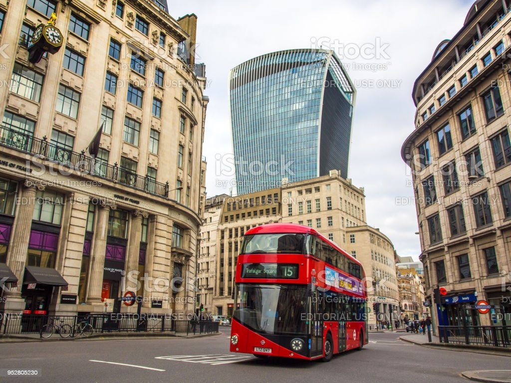 Iconic modern style double decker bus on London streets stock photo