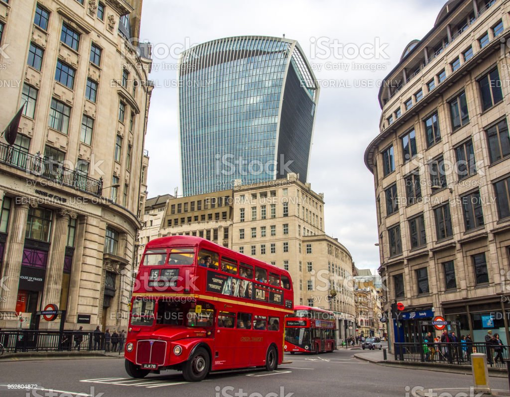 Iconic old style double decker bus on London streets stock photo