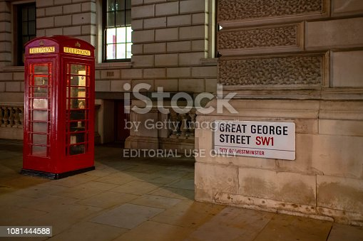 Iconic red British Telephone booth outside the Cabinet war rooms in London's Whitehall on Great George Street.