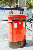 Iconic red post box in London. In the British Isles, the first red pillar post boxes were erected in Jersey in 1852.
