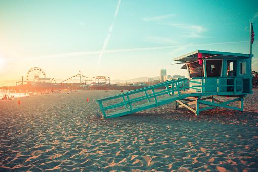Iconic Santa Monica rescue cabin against famous amusement park in sunset light