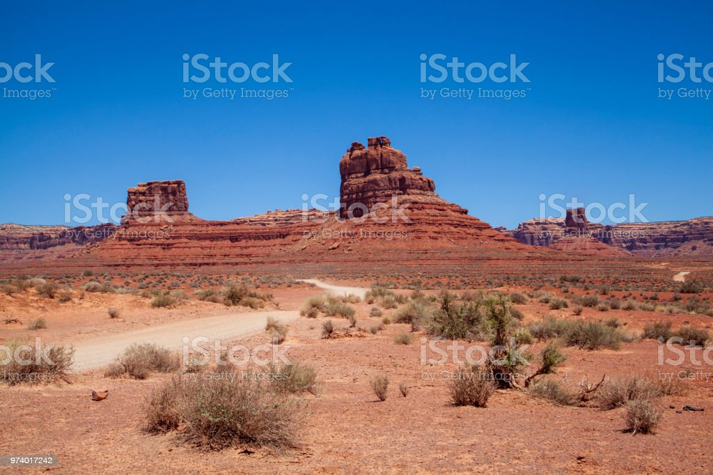 Iconic Southwest US desert brown sandstone monument in the former Bears Ear National Monument located in the Valley of the Gods, Mexican Hat, Utah stock photo
