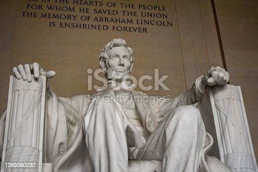 Close-up photo of the iconic statue of Abraham Lincoln, sculpted by Daniel Chester French, in the Lincoln Memorial in Washington, D.C.