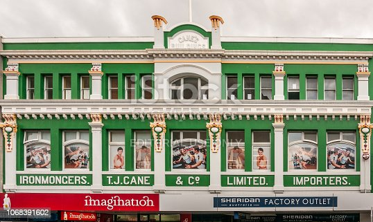 Hobart, Tasmania, Australia - December 14, 2009:  Iconic T.J. Cane building in Elizabeth street is painted grass green with golden trim and white pillars. Merchandise posters in windows.
