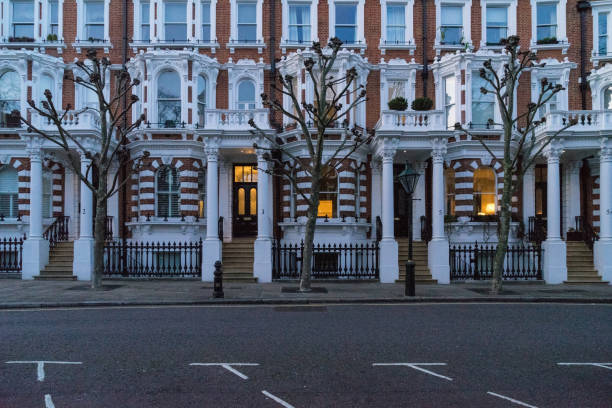 London - March 30: Iconic traditional row of town houses at night in Notting Hill on March 30, 2017. stock photo