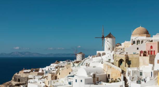 Iconic windmills of Santorini stock photo