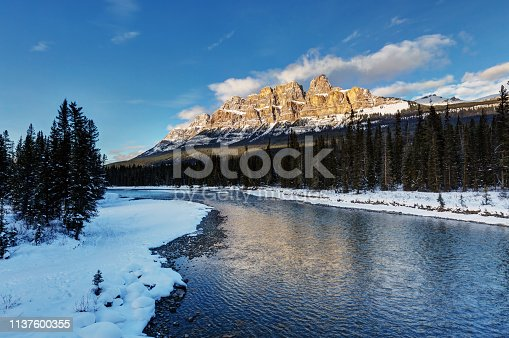 Iconic winter scene in the Canadian Rockies at the Banff National Park, Castle mountain in front of the bow river