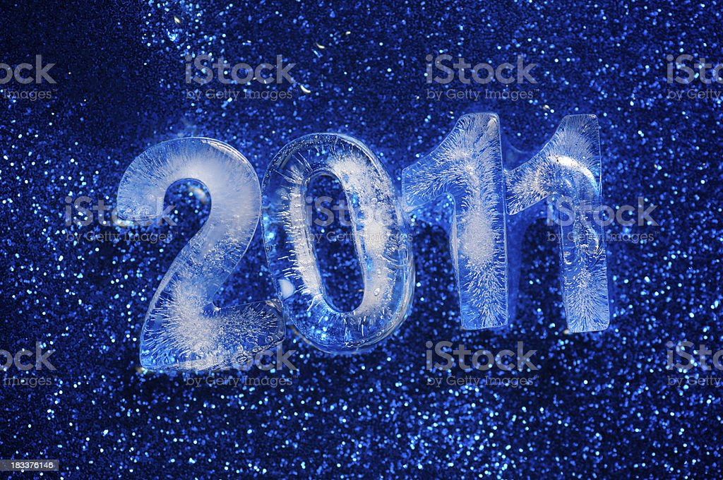 Icy 2011 Message Shines on Sparkly Blue Background royalty-free stock photo