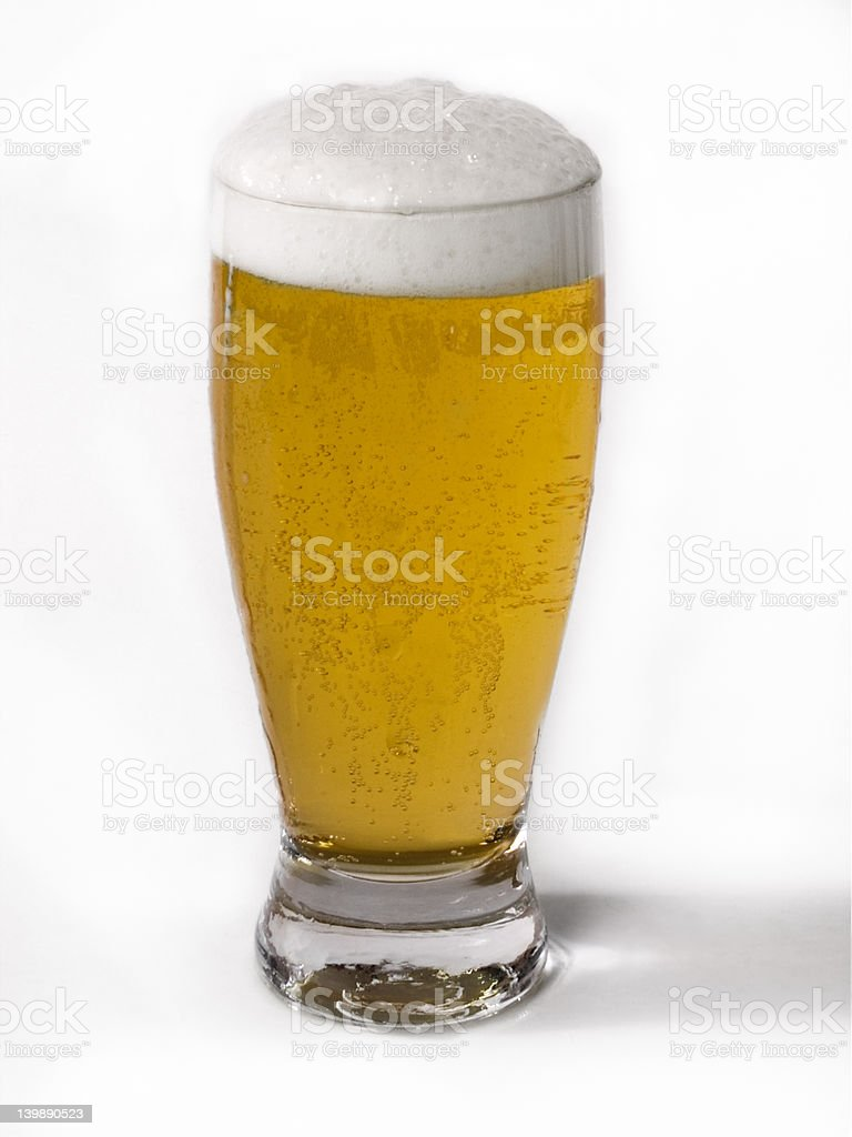 Icy cold frosty draft beer in glass royalty-free stock photo