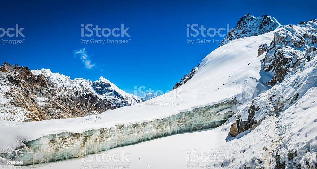Icy glacier crevasse on mountain wilderness pass snowy summits Himalayas stock photo