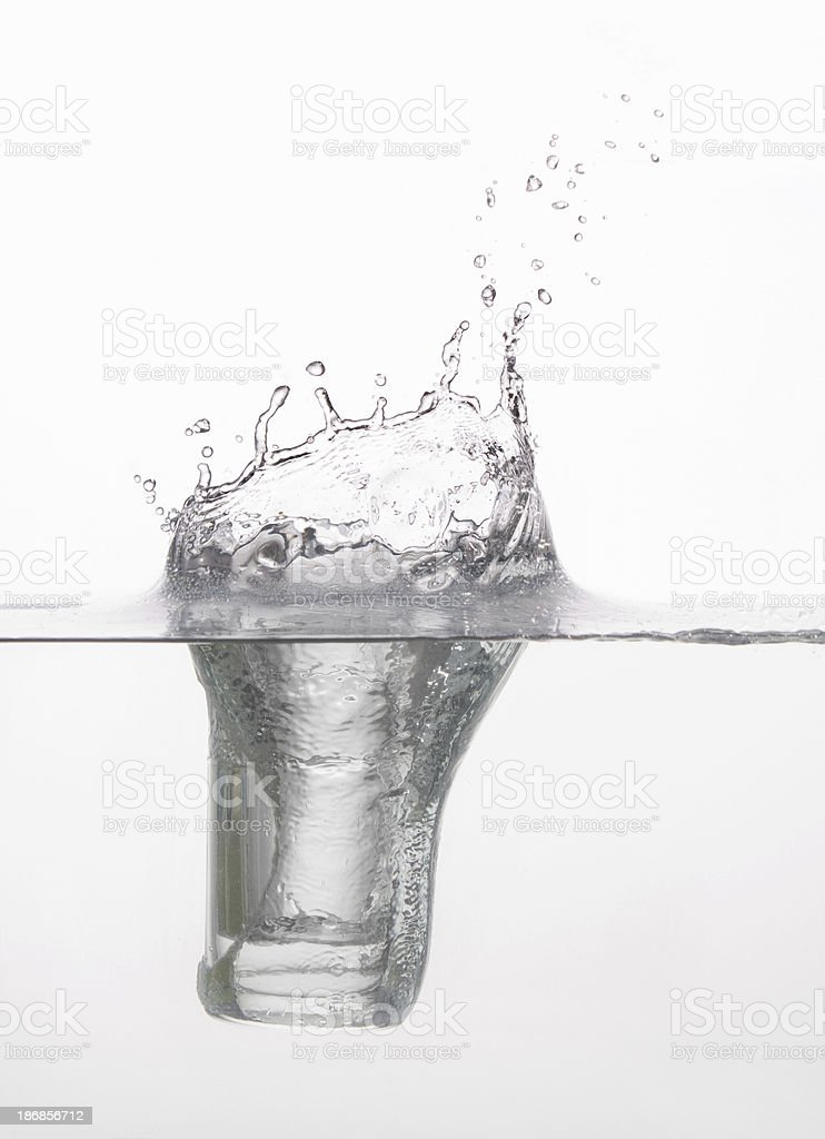 Icy glass splashing into the perfect water royalty-free stock photo