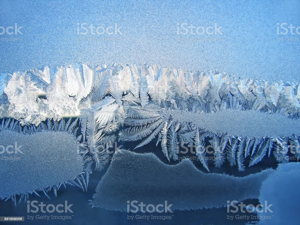Icy natural pattern on winter window glass stock photo