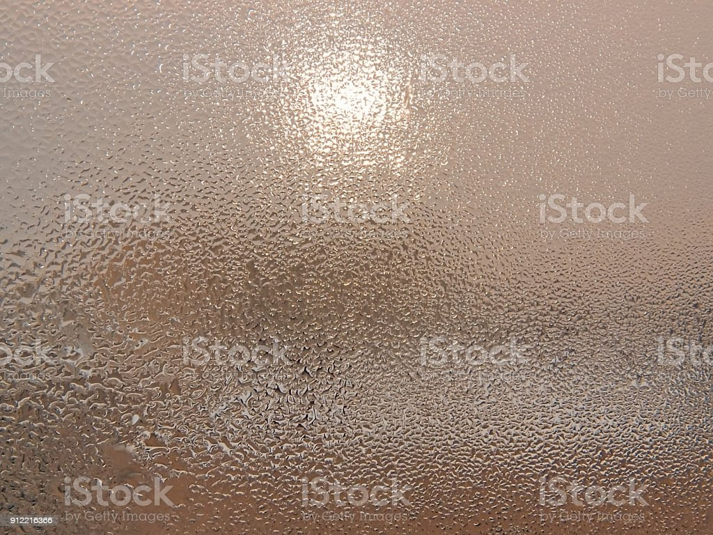 Icy pattern on the glass stock photo