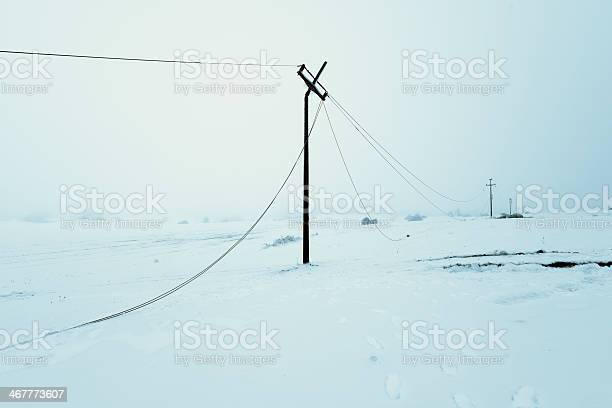 Photo of Icy Power Poles Falling