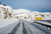 Honningsvag, Norway - March 30, 2013: Icy road to the North Cape in winter