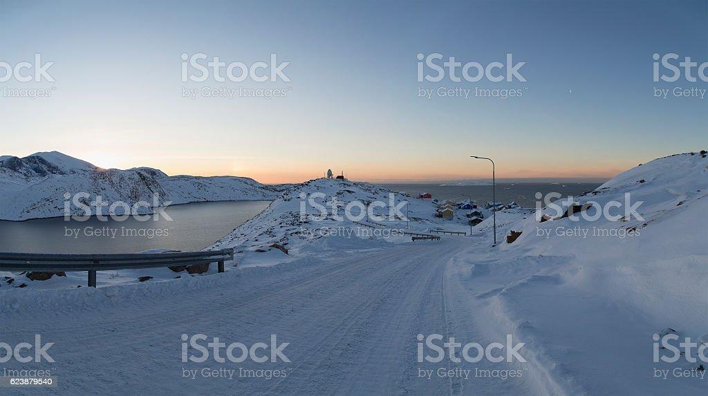 icy road to Upernavik overlooking bay stock photo