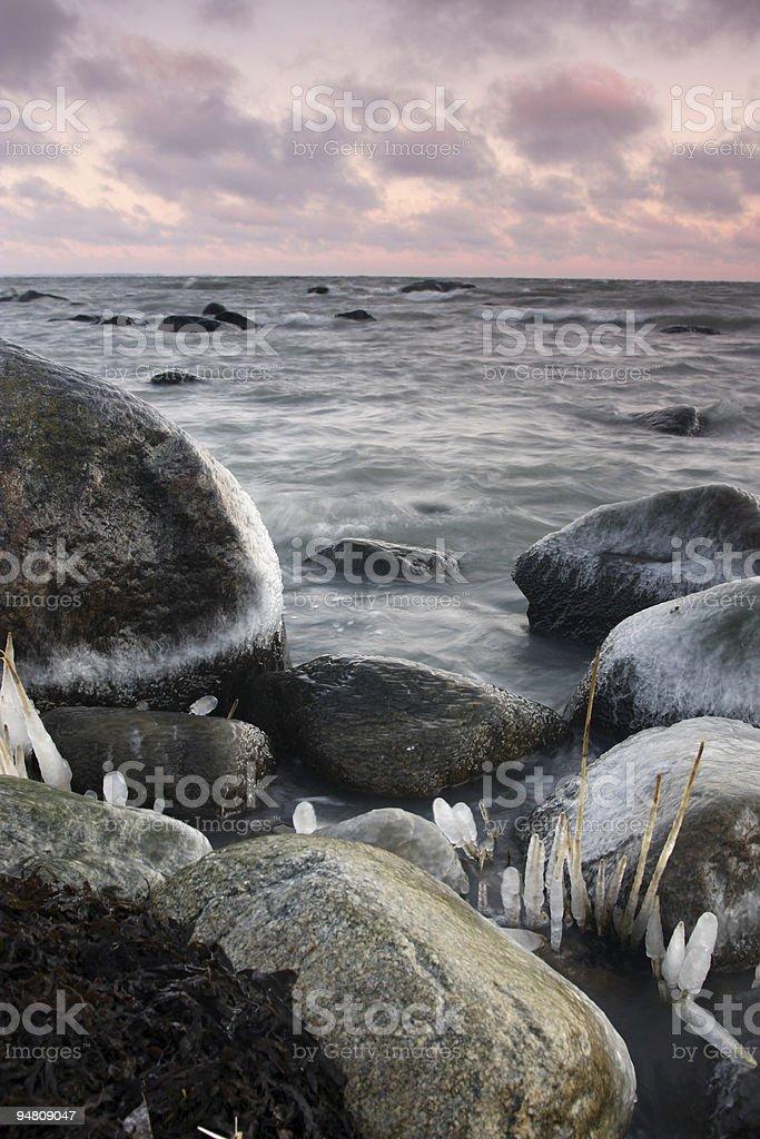 Icy stones at sunrise royalty-free stock photo