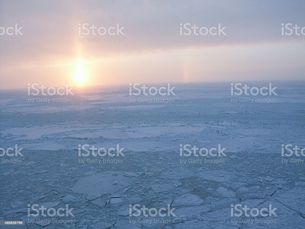 icy sunrise stock photo