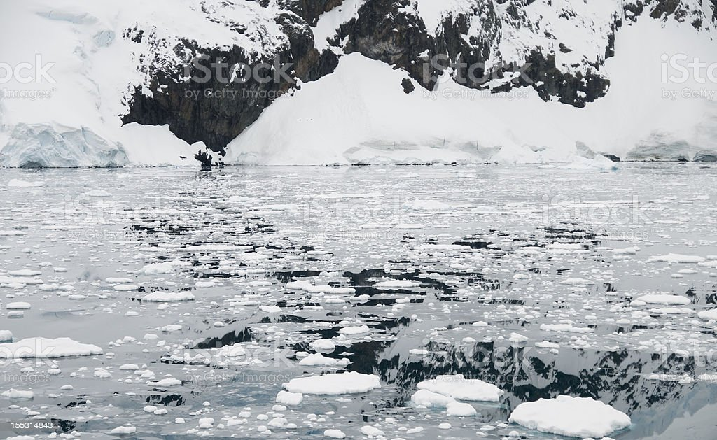 Icy Waters and Mountain Reflection stock photo