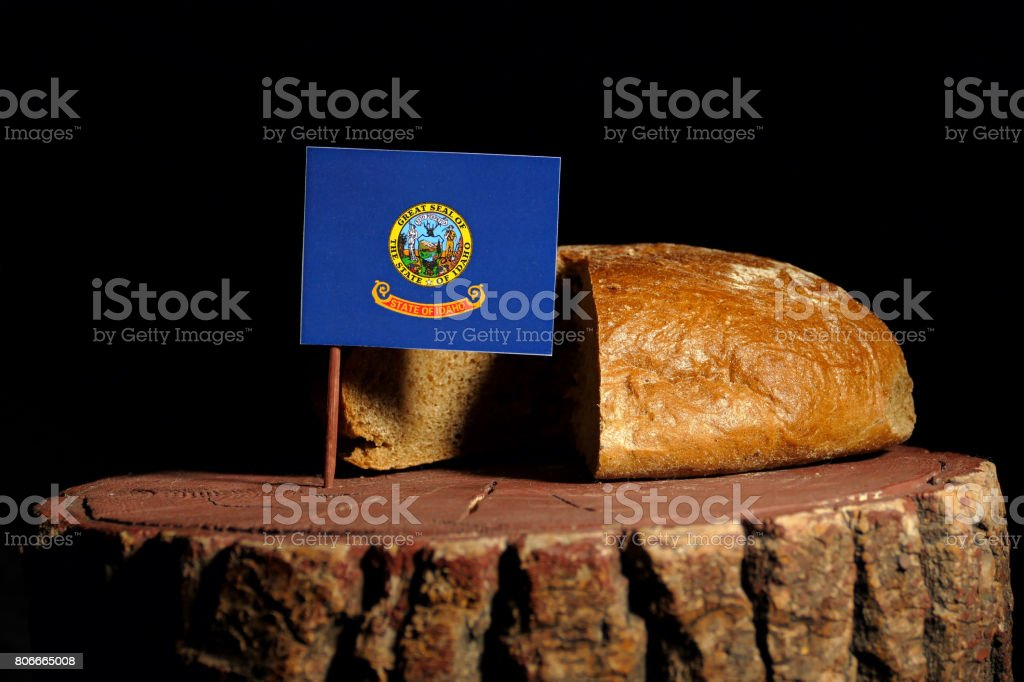 Idaho flag on a stump with bread isolated stock photo