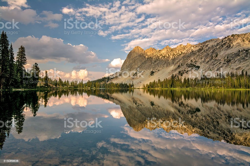 Idaho mountain lake and cloud reflection stock photo