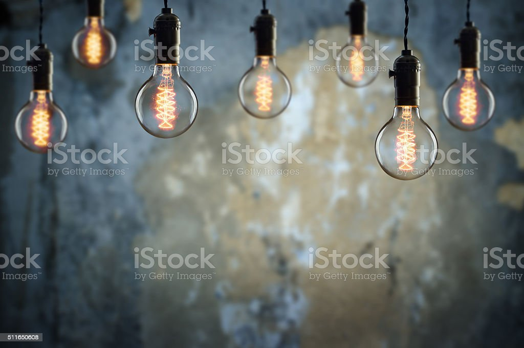 Idea and teamwork concept Vintage  bulbs on wall background stock photo