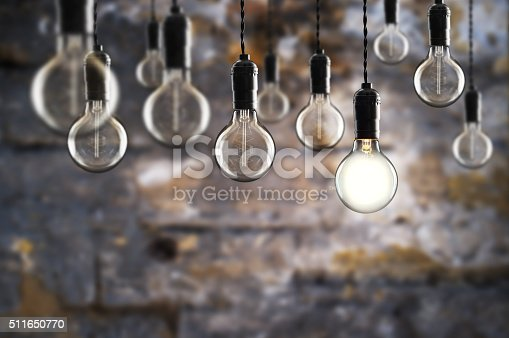 istock Idea and teamwork concept Vintage  bulbs on wall background 511650770