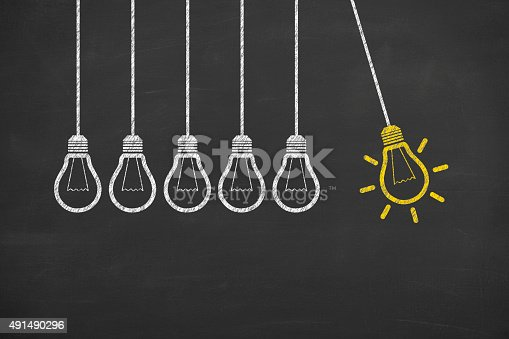 istock Idea Bulb Concept Drawing on Blackboard 491490296
