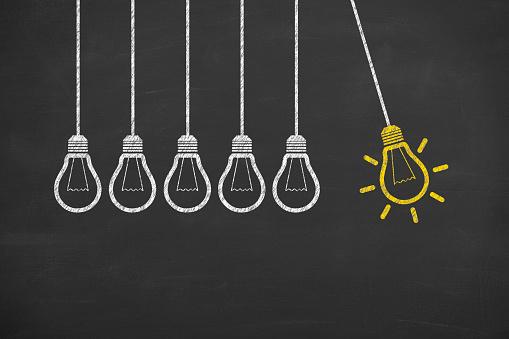 istock Idea Bulb Concept Drawing on Blackboard 491490296