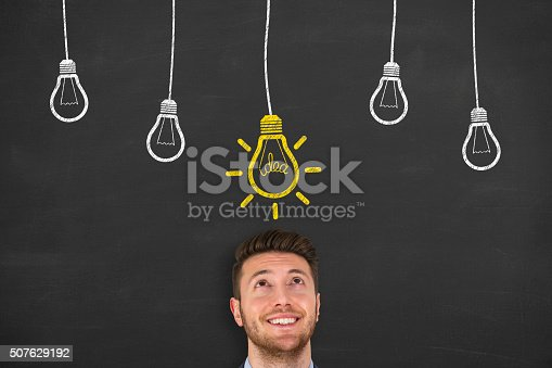 645716366 istock photo Idea Bulb Concept Drawing on Chalkboard 507629192