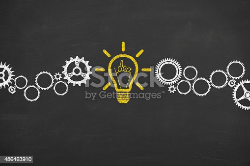 istock Idea Bulb Concept Drawing Working on Blackboard 486463910