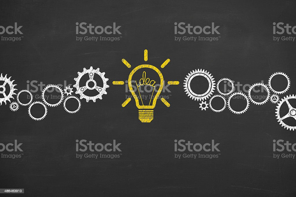Idea Bulb Concept Drawing Working on Blackboard stock photo