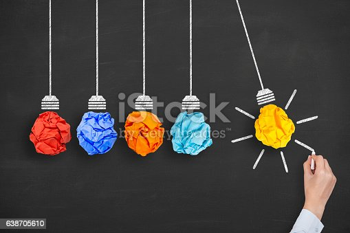 istock Idea Concept Light Bulb Crumpled Paper on Blackboard Background 638705610