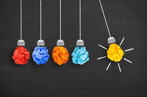 istock Idea Concept Light Bulb Crumpled Paper on Blackboard 607493026