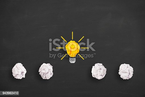 istock Idea Concept Light Bulb Crumpled Paper on Blackboard 943963410