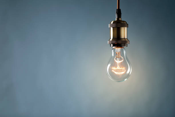 idea concept on blue background - light bulb stock pictures, royalty-free photos & images