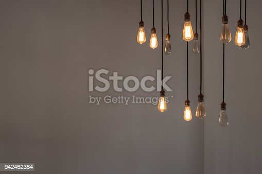 istock Idea concept with good and broken light bulbs hanging from ceiling 942462384