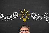 istock Idea concepts with light bulbs on a chalkboard 653161230