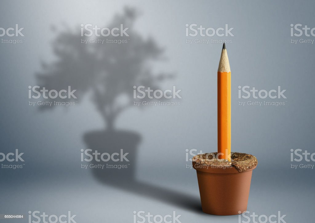 Idea creative concept, pencil growing from pot stock photo