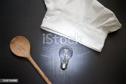 istock Idea for cooking food abstract concept with bulb and chef's hat in the kitchen 1049194990